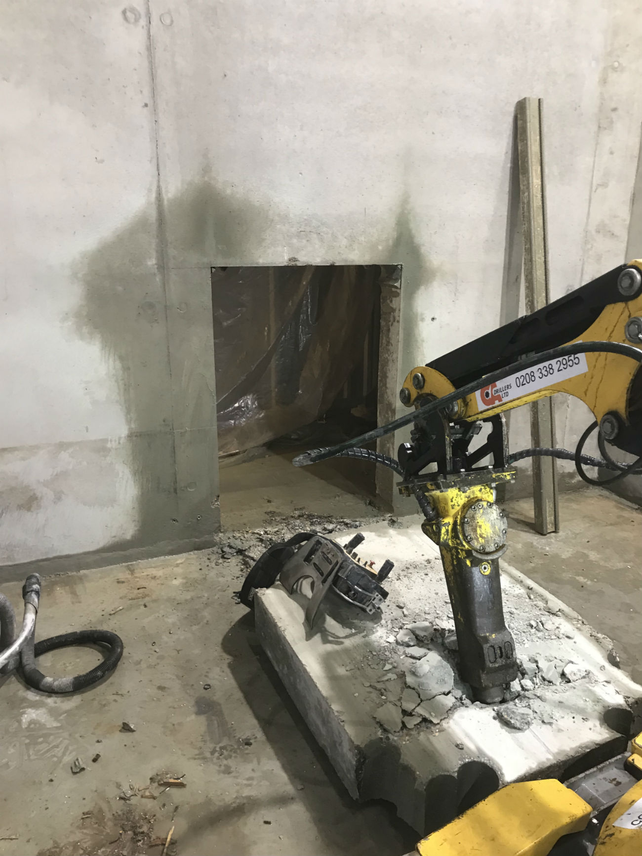 Brokk machine to pull out a reinforced concrete block