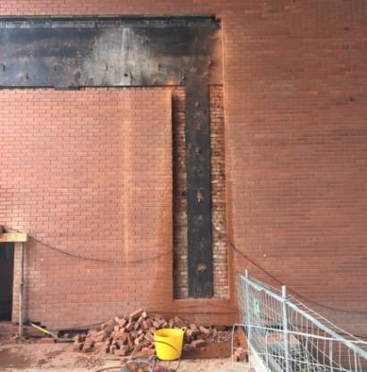 Track saw of brick wall